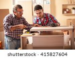 two carpenters working at... | Shutterstock . vector #415827604