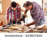 two carpenters working at... | Shutterstock . vector #415827640
