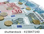 money euro coins and banknotes | Shutterstock . vector #415847140