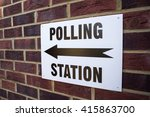 A Sign Outside A Polling...