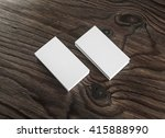 Blank business cards dark wooden background. White business cards. Blank template for branding identity. Top view.