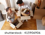 young couple unpacking... | Shutterstock . vector #415906906