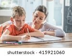young boy doing his school... | Shutterstock . vector #415921060