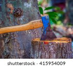 Old Axe In Stump In The...