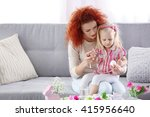 mother and daughter decorating... | Shutterstock . vector #415956640