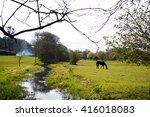 stream flowing through a field... | Shutterstock . vector #416018083