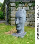 Small photo of PORTO, PORTUGAL - JUNE 4, 2015: Untitled artwork by Portuguese sculptor Antonio Campos Rosado, in shape of stone head. The statue exposed in Crystal Palace Gardens.