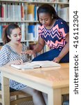 two beautiful girls studying in ... | Shutterstock . vector #416112304