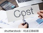 Small photo of holds card with text cost on financial report and calculator
