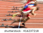 Small photo of sprint start in track and field in blurred motion