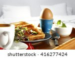 breakfast time in bed and egg... | Shutterstock . vector #416277424