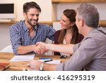 handshake of a mature manager... | Shutterstock . vector #416295319