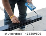 man use coat thickness meter... | Shutterstock . vector #416309803