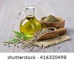 hemp oil n a glass jar and hemp ... | Shutterstock . vector #416320498