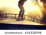 skateboarding woman riding... | Shutterstock . vector #416328598