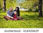 happy loving family on flowery... | Shutterstock . vector #416420629