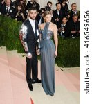 Small photo of May 2, 2016 - New York, New York, USA - Zayn Malik and Gigi Hadid arrive at the Metropolitan Museum of Art Costume Institute Gala Manus x Machina: Fashion in the Age of Technology