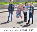 children playing skipping rope... | Shutterstock . vector #416671453