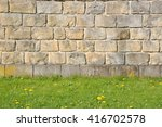Stone Wall With Green Grass