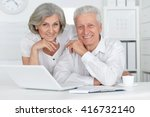 senior couple  with laptop | Shutterstock . vector #416732140