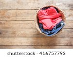 Stock photo  top view clothes in a laundry basket on wood floor 416757793