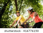 Young Smiling Couple Riding...