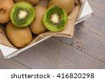 box of fresh kiwi in on wooden... | Shutterstock . vector #416820298