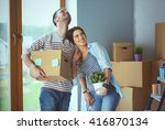 happy young couple unpacking or ... | Shutterstock . vector #416870134