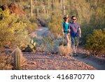 two afternoon desert hikers in... | Shutterstock . vector #416870770