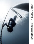 free diver descending along the ... | Shutterstock . vector #416872480