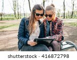 two girl sitting on the bech in ... | Shutterstock . vector #416872798
