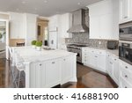 Stock photo kitchen interior with island sink cabinets oven range and hardwood floors in new luxury home 416881900