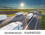 many delivery trucks driving... | Shutterstock . vector #416940103