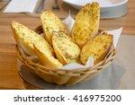cheese garlic bread in basket   Shutterstock . vector #416975200