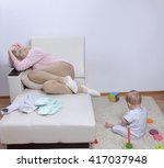 Woman Sits With Her Child ...
