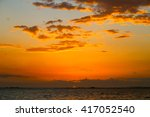 Tangerine Sunset Sky Above The...