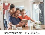 a modern family using a digital ... | Shutterstock . vector #417085780