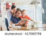 a modern family using a digital ... | Shutterstock . vector #417085798