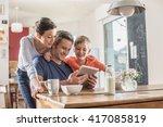 a modern family using a digital ... | Shutterstock . vector #417085819
