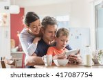 a modern family using a digital ... | Shutterstock . vector #417087754