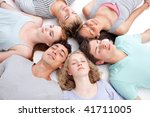 teens sleeping on floor with... | Shutterstock . vector #41711005
