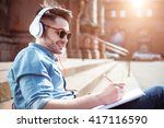 delighted guy sitting on the... | Shutterstock . vector #417116590