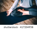 young woman meditates while... | Shutterstock . vector #417204958