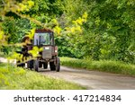 Farmer Drives Tractor On Road