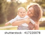 mama and her little son walking ...   Shutterstock . vector #417220078