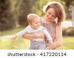 mama and her little son walking ...   Shutterstock . vector #417220114