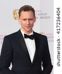 Small photo of LONDON - MAY 8, 2016: Tom Hiddleston arrives for the House Of Fraser British Academy Television Awards at the Royal Festival Hall on May 8, 2016 in London