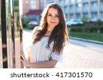 beautiful girl in a white dress ... | Shutterstock . vector #417301570