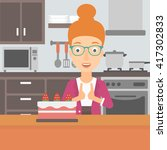 woman looking at cake.   Shutterstock .eps vector #417302833