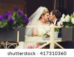 groom kisses bride's nose at... | Shutterstock . vector #417310360